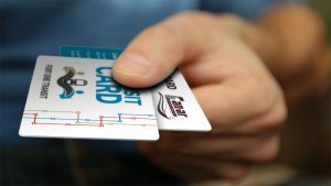 man holding fort erie transit smart card